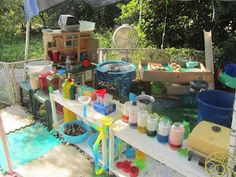 science, kitchen, water play center in outdoor play environment