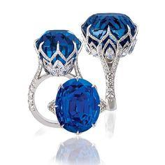Jack Abraham. Beautiful 38 carat oval ceylon sapphire ring with high-grade diamonds and fine detail.
