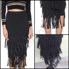 "SASSY FLIRTY FRINGE SKIRT Be awesome in this black fringe skirt! 4 full layers of 6"" fringe all the way around this beautiful fabric skirt, polyester/nylon/spandex blend, elastic banded waist, can be worn high on waist or lower on hip. Overall length to bottom fringe is 25 1/2"" approx. JS Signature Skirts"
