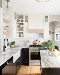 We were lucky enough to chat with our brand ambassador, @briahammelinteriors about all things kitchen remodeling! She shares her tips on how to approach a kitchen remodel. How gorgeous is this kitchen refresh she did - we're in love! Link in bio. ​ Black Kitchen Cabinets, Kitchen Interior, Kitchen Cabinet Design, Kitchen Cabinets, Kitchen Vignettes, Kitchen Remodel, The Tile Shop, Kitchen Renovation, Kitchen Design