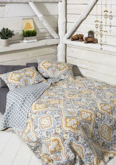 Your room's story is staged with your bed next to a window so the sun can illuminate this grey quilt. Designed with an ornate damask print in goldenrod and ivory tones, this luxe comforter and its matching shams create depth of design - and that's just the first of your decorating ideas!