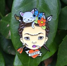 """This months pin is a collaboration with the ever so talented Corey Davis!! Since July is Frida Kahlo appreciation month - we are releasing 2 pins to celebrate her life. """"Vida"""" for her birthday July 6th 1907 """"Muerte"""" for  her death July 13th 1954Theres exactly 100 of each pin. A % will go back to Casa Azul to help maintain her legacy and her beloved home. All pins start shipping out July 8thShipping included in priceAll Sales Final Please c..."""