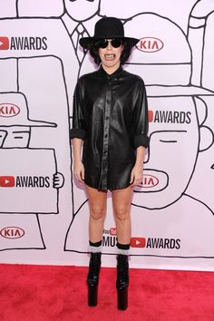 Lady Gaga in the red carpet for the YTMA. She wore a Saint Laurent shirt and a kind of dental grills. November 3, 2013. New York City.