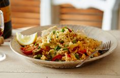 This vegetarian paella is bursting full of fresh flavours & vegetables; you won't even miss the meat! Try this tasty vegetarian recipe at Tesco Real Food.
