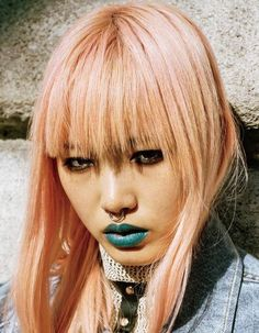 Supermodel Fernanda Ly is featured in a beautiful spread in Teen Vogue, which is sure to provide ample inspiration.  For the hair: Bleach your locks to a level 9 or 10 blonde, and then add our Cotton Candy Pink into your daily conditioner. Each time you wash your hair, you will get a subtle rosy sheen, just like she has. (http://www.manicpanic.com/high-voltage-cream-formula-hair-color#92=40)  For the lips: Get our Green Envy Lethal Lipstick (http://www.manicpanic.com/lethal-lipstick#183=50)