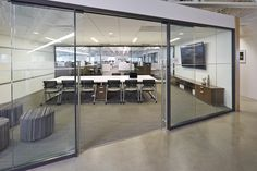 This large meeting space features an Epic conference table with Jiminy seating. The Epic casegoods on the wall provides storage and the Whimsy impromptu seating provides additional seats, if needed. The Exhibit Wall Rail Solution adds marker board capabilities to boost productivity and maximize usable vertical space. #NationalOffice #NationalHQ #FurnitureWithPersonality