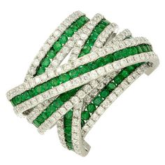 "Wonderful 18K White Gold Emerald and Diamond ""Twisted"" Band"