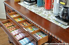 use drawers to organize tea or other drinks in a self-serve coffee bar for guests