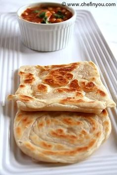 Malaysian Roti Cani. This stuff is a seriously tasty alternative to rice with curry. We've bought them frozen a few times. This looks like a clear recipe to make them, which I will in future. At the moment I can't quite convince myself they're healthy enough.