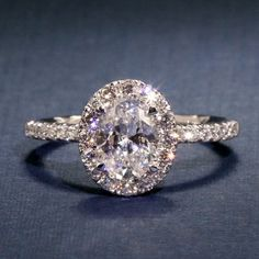 A Jaffe Oval Halo Engagement Ring with Belted Gallery style ME2168Q - 1.5CT 14KW #weddingring #ringly