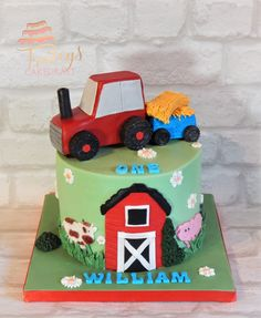 Farm theme 1st birthday cake with edible tractor