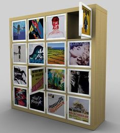 This cupboard shelf from Ikea is meant for album covers, but I could see blowing up photos or other prints to fit.