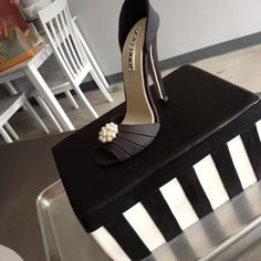 Jimmy Choo modelling fondant shoe and shoe box cake