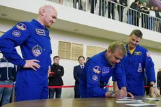 ASTRONAUTS TAKE EXAMS TOO! - ESA astronaut Alexander Gerst (left) and NASA astronaut Reid Wiseman look on as their Expedition 40 commander Maxim Suarev signs exam forms. Today, the crew had their first day of tests on the Russian segment of the Space Station. Exams last all day and see the astronauts dealing with a range of demanding scenarios, with the examiners surprising them with emergency situations.