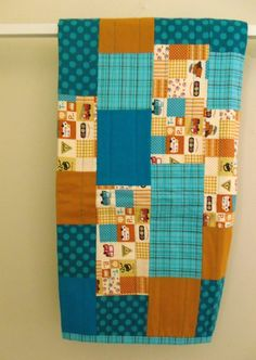 Organic Baby Quilt, Modern Traffic in Teal and Mustard. $110.00, via Etsy.
