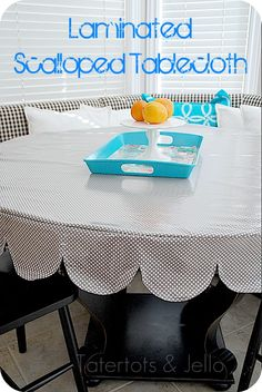 I love the scallops on this tablecloth - and with laminated fabric, it's even better! (and easier to make with edges that don't need to be finished)
