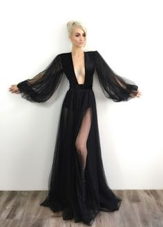 Absolutely flawless black, long sleeve evening gown with plunging neckline designed by Michael Costello featured in dark glamour blog 1486.
