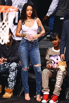 "Rihanna at a basketball game between the ""Brooklyn Nets"" and the ""Toronto Raptors""  in NYC"