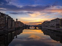 Like the floating clouds and flowing streams: The evening sky above the Arno: Firenze, Italy