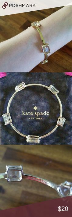 Kate Spade bangle High quality Kate Spade bangle embellished with clear gems of different shapes. Gently used and comes with the dust bag. kate spade Jewelry Bracelets