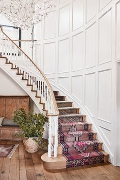 Hilary Duff for B H G - curved staircase with turkish kilim rugs Entryway Stairs, Rustic Stairs, Tile Stairs, House Staircase, Curved Staircase, Stair Railing, Staircase Design, Carpet Stairs, Staircases