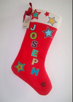 Personalised with the name of your choice (maximum 8 letters) Handmade in the UK Italian red wool felt stocking with applique wool felt and cotton fabric stars and letters. Lined with calico fabric and finished with soft. Fabric Stars, Felt Stocking, Calico Fabric, Red Satin, Vintage Fabrics, Wool Felt, Christmas Stockings, Cotton Fabric, Applique