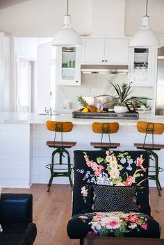 white kitchen, black chairs