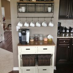 This blogger decided to quench her coffee thirst by making a homemade coffee station. I love the hanging cups, and the baskets and shelves attached to the wall. Sometimes it's okay to have things out in the open!