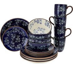 Brighten up your tabletop with this colorful Temp-tations set. The pretty, hand-painted Floral Lace motif decorates this ceramic dinnerware set with service for four, including dinner plates, salad plates, and serving bowls. QVC.com