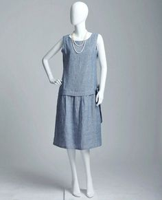 A simply lovely flapper day dress inspired by the drop waist style of 1920s fashion. It is made of fine quality pure linen fabric from Japan. The color is a mix of grey and blue creating denim look. To make sure that there is no need for a slip we add a lining to it, which is made of thin, lightweight and soft cotton voile in grey color. Both fabrics have been preshrunk and you can wash the dress in the washing machine. The dress is loose fitting and sleeveless and comes with a bow on the…