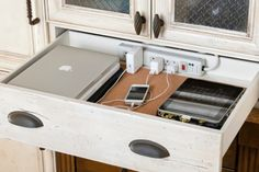 shallow drawer in kitchen (or entry area) with power strip for tech charging centre
