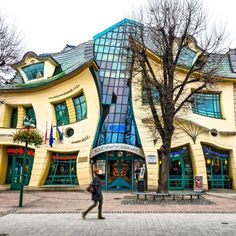 Krzywy Domek means Crazy House in Polish, which is quite appropriate for a building that looks like it got stuck in a fun house mirror.