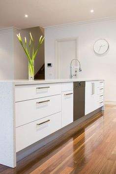 Modern Kitchen Gorgeous white kitchen with natural floorboards that look incredible with some highlights. Have a look for some great kitchen ideas. Kitchen Cabinets Decor, Kitchen Layout, Home Decor Kitchen, New Kitchen, Kitchen Ideas, Kitchen Pics, Kitchen White, Cabinet Decor, Cabinet Makeover
