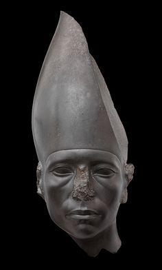 Head of a Statue of Amenemhat III Wearing the White Crown. Provenance unknown; acquired in Cairo, 1894. Twelfth Dynasty, reign of Amenemhat III (ca. 1859–1813 B.C.). Graywacke; H. 18 in. (47 cm ), W. 7 in. (18.5 cm). Ny Carlsberg Glyptotek, Copenhagen (AEIN 924). Photograph by Anna-Marie Kellen