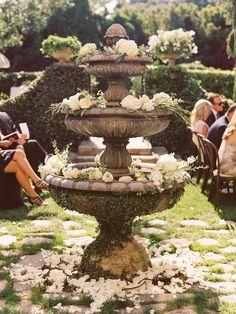 Elegant- lovely garden fountain overflowing with blooms