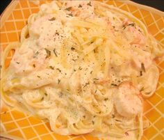 Shrimp Fettuccine Alfredo from Food.com:   								In this flavorful dish, you can adjust the amounts to suit your personal tastes...I happen to like garlic and Parmesan cheese. If you have any leftovers, you can add a little more milk and heat briefly in the microwave oven.
