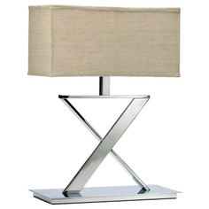 We have a pair of these elegant chrome x-base deco lamps with linen fabric rectangular shades.  Call Cerulean for pricing ~850-249-3873.