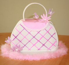Purse Cake----I did one similar for Annalyse when she turned four. They are fun!