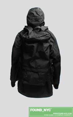 This Soft Shell jacket by Acronym collapses into the backpack. The piece comes with optional front bags on the backpack straps. This piece also came with a foldaway scooter. Pretty cool. Although reviews were negative about the scooter...