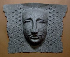 Illusion: Origami craftsman Joel Cooper has been perfecting his folding technique for many years. Although, it looks like some of his masks use strips of paper weaved in one another, in reality, it is done with meticulous folds from a single sheet.     (Photo © Cooper)    http://illusion.scene360.com/art/25800/intricate-origami-masks/