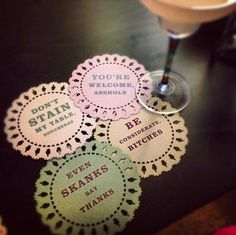"""""""Indelicate coasters."""" Notice the hole-punch is a middle finger? Klassy."""
