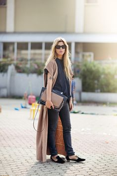Shop this look on Lookastic:  http://lookastic.com/women/looks/crossbody-bag-and-skinny-jeans-and-loafers-and-crew-neck-t-shirt-and-sleeveless-coat/2913  — Brown Crossbody Bag  — Black Skinny Jeans  — Black Suede Loafers  — Black Crew-neck T-shirt  — Camel Sleeveless Coat