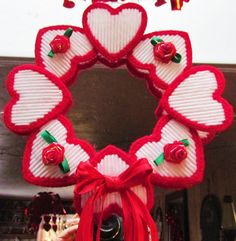 made using the pre-cut heart shaped plastic canvas Plastic Canvas Books, Plastic Canvas Ornaments, Plastic Canvas Tissue Boxes, Plastic Canvas Christmas, Plastic Canvas Crafts, Plastic Canvas Patterns, Plastic Sheets, Valentine Day Wreaths, Valentines Day Decorations