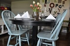 Such lovely dusty tiffany blue painted chairs and black painted table.