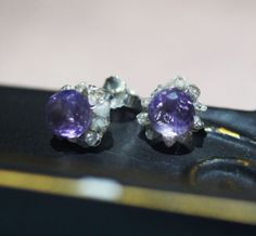 Amethyst center stone surrounded by rough champagne diamonds, in sterling.