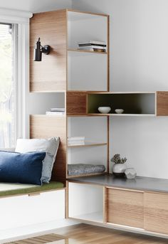 Doherty Design Studio.  living room banquette seating with interesting joinery and shelving design