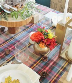Blogger Jen covered her table in tartan scarves, then spray-painted vases from the Dollar Store to complement the pattern. She made the rustic wood slice cake stand herself, then topped it with a feather-filled vase. See more at City Farmhouse.   - CountryLiving.com