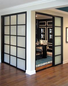 Black/white home office with room dividers by The Sliding Door Company.