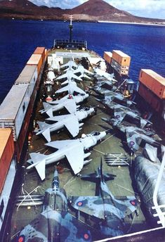 A squadron of Royal Air Force BAe Harrier GR.3s and Royal Navy BAe Harrier FRS.1s aboard Atlantic Conveyor off Ascension Island during the Falklands War, 1982