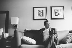 Groom poses for portraits on a couch on his wedding day at the Old Tappan Manor in Old Tappan, NJ. Captured by Northern New Jersey Wedding Photographer Ben Lau.